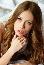 Ukrainian girl Kristina,21 years old with green eyes and light brown hair.