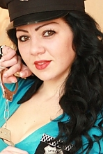 Ukrainian girl Alena,25 years old with black eyes and dark brown hair.