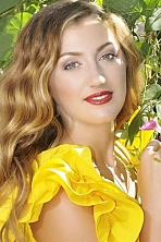 Ukrainian girl Oksana,30 years old with green eyes and blonde hair.