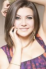 Ukrainian girl Marina,23 years old with brown eyes and dark brown hair.