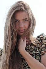 Ukrainian girl Victoria,19 years old with grey eyes and light brown hair.