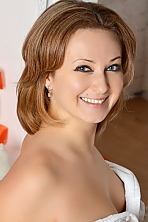 Ukrainian girl Svetlana,28 years old with blue eyes and light brown hair.