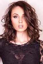 Ukrainian girl Valentina,20 years old with grey eyes and dark brown hair.