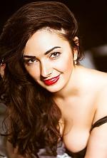 Ukrainian girl Yulia,26 years old with green eyes and black hair.