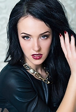 Ukrainian girl Ilona,21 years old with blue eyes and black hair.