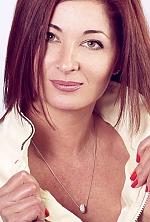Ukrainian girl Oksana,45 years old with green eyes and red hair.