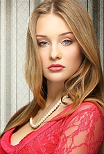 Ukrainian girl Marina,19 years old with blue eyes and blonde hair.