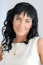 Ukrainian girl Anna,38 years old with brown eyes and black hair.