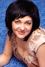Ukrainian girl Oksana,34 years old with blue eyes and black hair.
