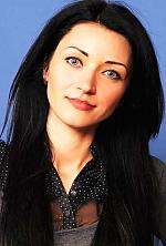 Ukrainian girl Tatyana,32 years old with grey eyes and black hair.