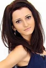 Ukrainian girl Irina,24 years old with hazel eyes and black hair.