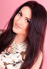 Ukrainian girl Alla,25 years old with hazel eyes and dark brown hair.