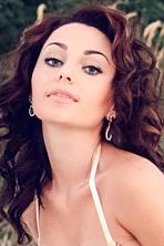 Ukrainian girl Yuliya,25 years old with green eyes and dark brown hair.