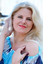 Ukrainian girl Elena,41 years old with green eyes and blonde hair.