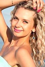 Ukrainian girl Tatiyna,27 years old with blue eyes and blonde hair.