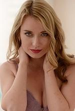 Ukrainian girl Julia,28 years old with grey eyes and blonde hair.