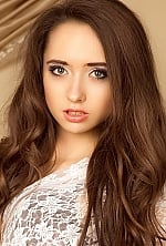 Ukrainian girl Anna,20 years old with grey eyes and light brown hair.