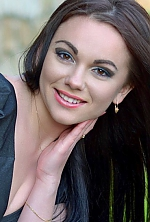 Ukrainian girl Yana,25 years old with brown eyes and black hair.