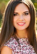 Ukrainian girl Olesya,30 years old with brown eyes and dark brown hair.