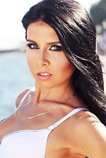 Ukrainian girl Dasha,27 years old with blue eyes and black hair.