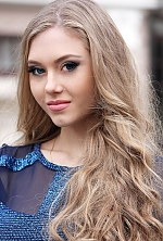 Ukrainian girl Asya,19 years old with blue eyes and blonde hair.