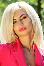 Ukrainian girl Marina,35 years old with brown eyes and blonde hair.