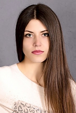 Ukrainian girl  Yana,20 years old with grey eyes and dark brown hair.