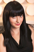 Ukrainian girl Anna ,28 years old with black eyes and black hair.