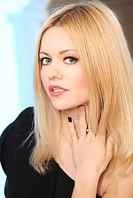 Ukrainian girl Liliana,38 years old with grey eyes and blonde hair.