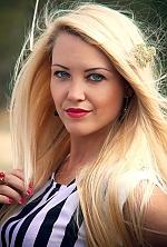 Ukrainian girl Nataliya,29 years old with grey eyes and blonde hair.