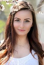 Ukrainian girl Victoriya,18 years old with brown eyes and dark brown hair.