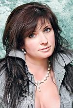 Ukrainian girl Oksana,41 years old with blue eyes and dark brown hair.
