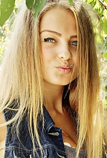 Ukrainian girl Lada,18 years old with blue eyes and blonde hair.