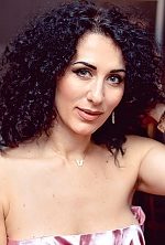 Ukrainian girl Nellya,44 years old with grey eyes and dark brown hair.