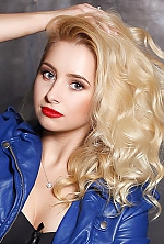 Ukrainian girl Anna,24 years old with grey eyes and blonde hair.