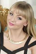 Ukrainian girl Julia,24 years old with hazel eyes and blonde hair.