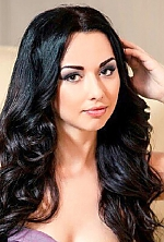 Ukrainian girl Katerina,24 years old with green eyes and black hair.