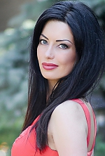Ukrainian girl Anna,28 years old with grey eyes and dark brown hair.
