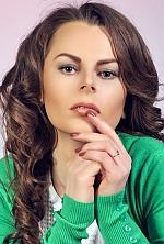 Ukrainian girl Olga,22 years old with black eyes and dark brown hair.
