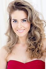 Ukrainian girl Luda,28 years old with blue eyes and light brown hair.