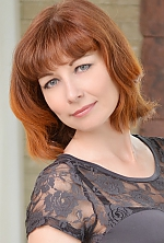 Ukrainian girl Elena,37 years old with green eyes and red hair.