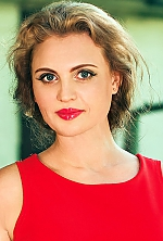 Ukrainian girl Ludmila,45 years old with grey eyes and light brown hair.