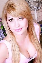 Ukrainian girl Elena,40 years old with hazel eyes and blonde hair.