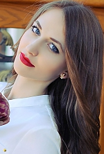 Ukrainian girl Irina,22 years old with blue eyes and dark brown hair.