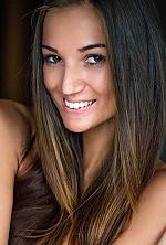 Ukrainian girl Tatiana,26 years old with brown eyes and dark brown hair.