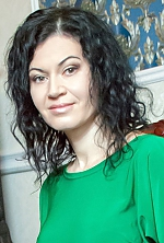 Ukrainian girl Irina,43 years old with hazel eyes and black hair.