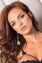 Ukrainian girl Natalia,25 years old with blue eyes and dark brown hair.