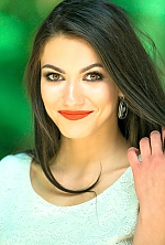 Ukrainian girl Lilia,20 years old with brown eyes and black hair.