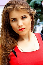 Ukrainian girl Elena,20 years old with grey eyes and blonde hair.