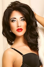 Ukrainian girl Anna,22 years old with blue eyes and dark brown hair.